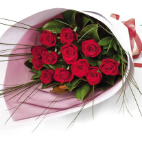 12 premium red Roses, seasonal foliage amd fillers, roll wrapped in white card or similar with ribbon and trimmings
